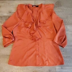 Limited burnt orange blouse with poet ruffle